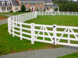 Vinyl Fence with stone house