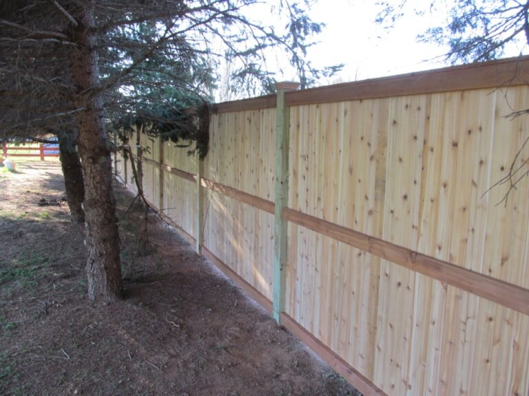Panel Fence in Tree Row