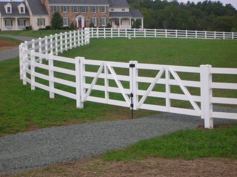 White fence in front of stone house