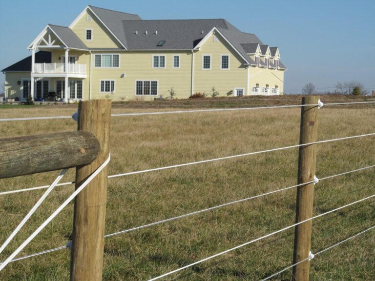 Large Yellow house with horse fence