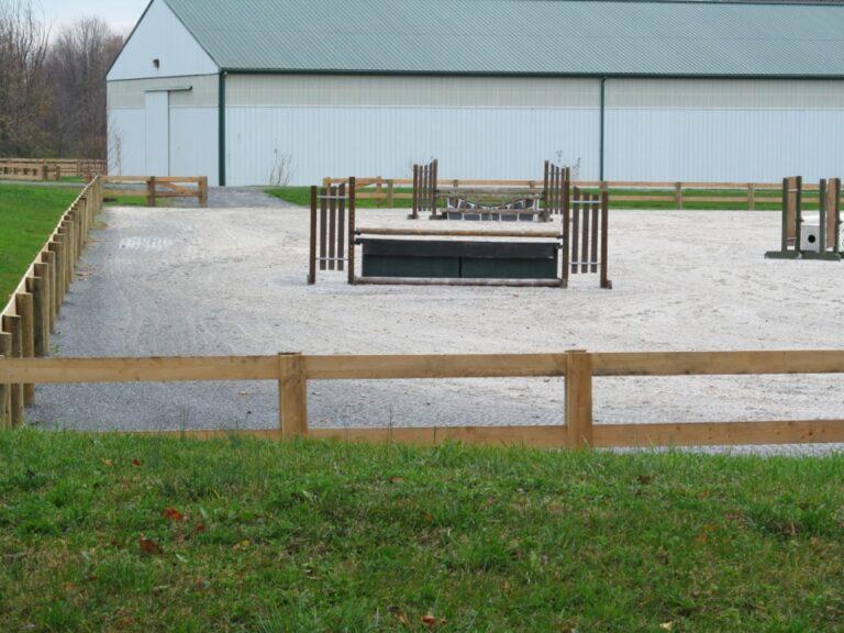 wooden fence around horse arena