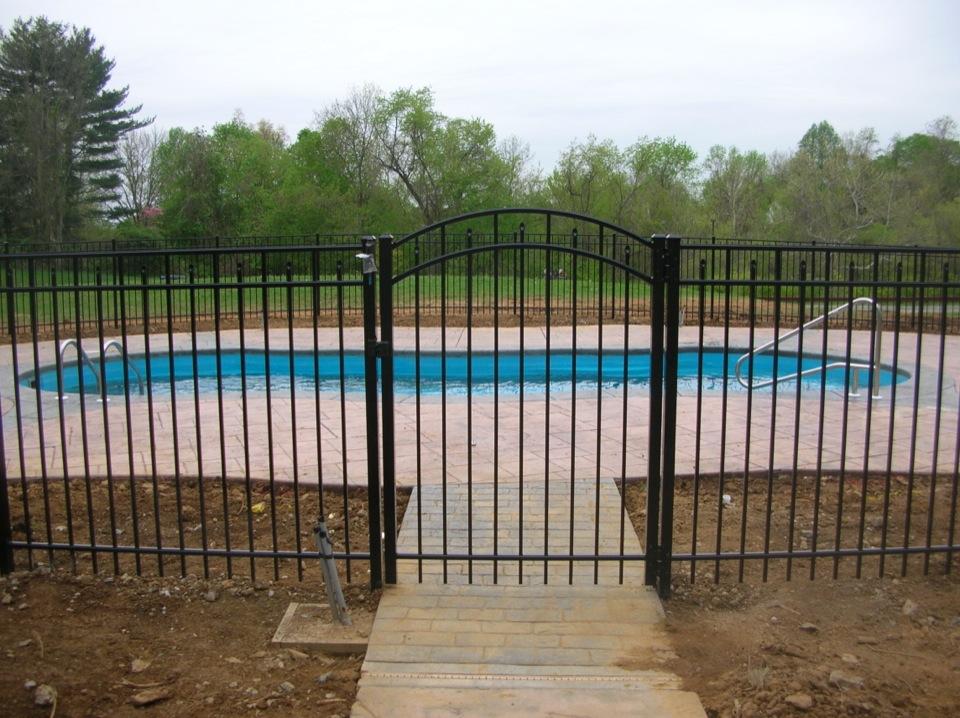 Black fence around pool