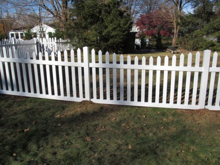 White picket fence with Tree