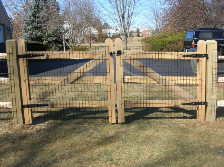 Wooden gate with overlaid mesh wire