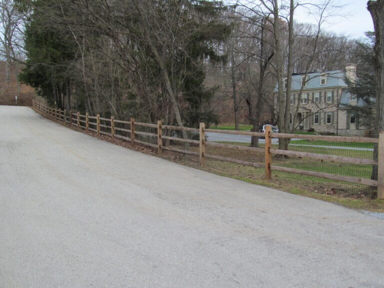 Rail Fence in front of stone house