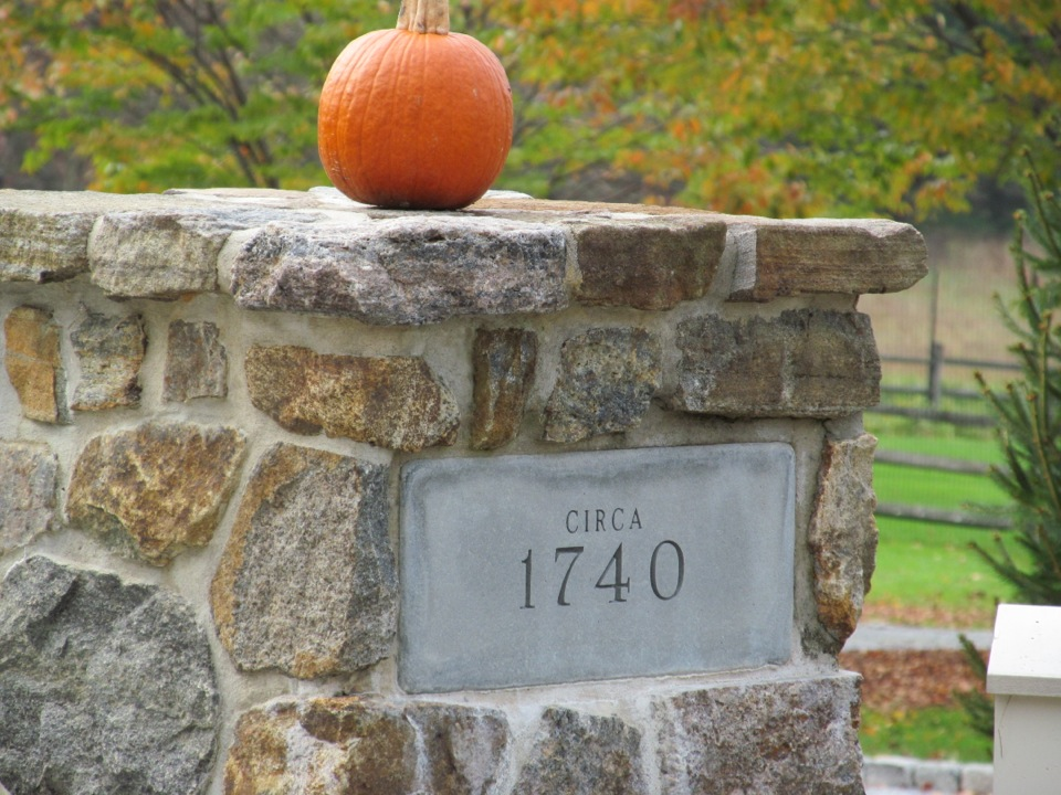 Pumpkin on top of stone wall