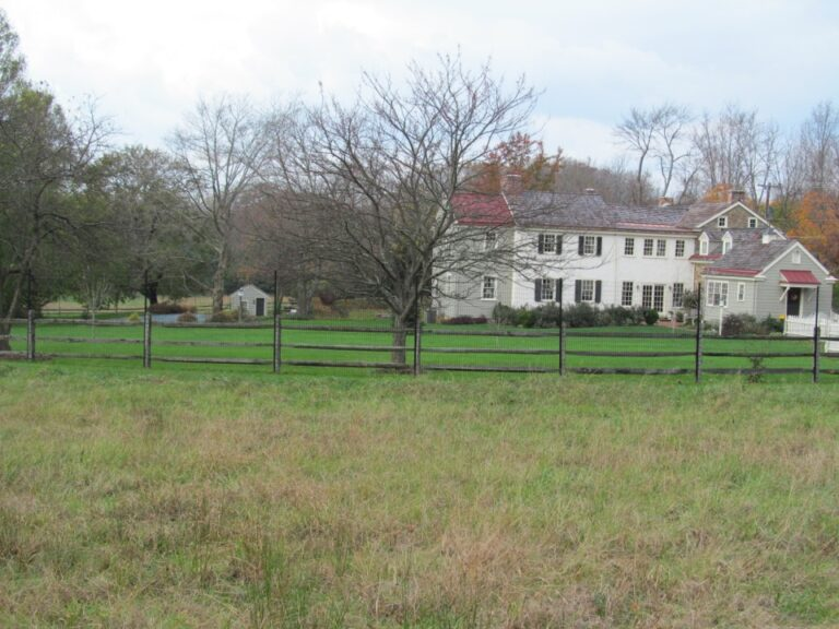 Rail Fence with Large House in background