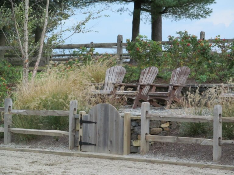 Chairs behind rail fence